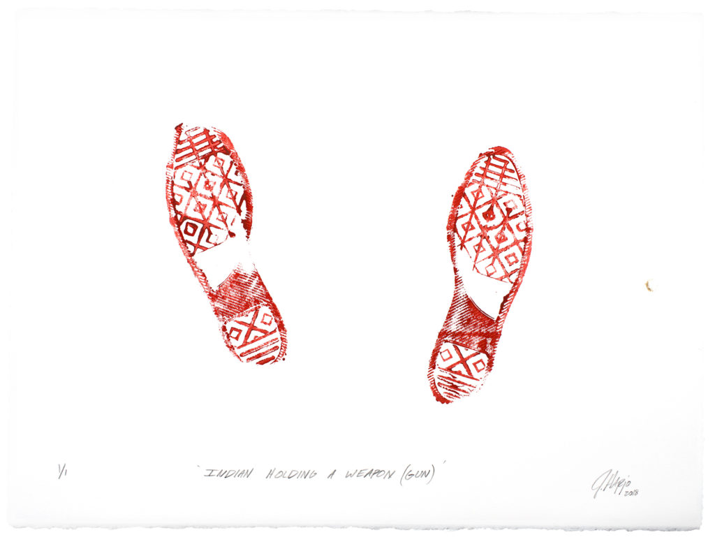 "On creamwhite paper, in brightred ink, the imprint of footwear with a complex tread, made up of voided lozenges under the sole and heel, horizontal bars at the toe and end of the heel, and an oblique block under the arch beginning at the heel and ascending to the instep halfway up. Vertical bars transverse the voided lozenges along the sole, bisecting them. Both feet are splayed slightly outward, and that on the left is placed slightly ahead, and angled outward slightly more than that on the right. The inner tip of the toe of the left foot has not made contact with the paper, nor that the outer edge of the heel of the right. Beneath, in blackinked oblique print hand, ""INDIAN HOLDING A WEAPON (GUN)"", and in the bottom right corner, the cursive signature J Harjo 2018"", where the data is in subscript."