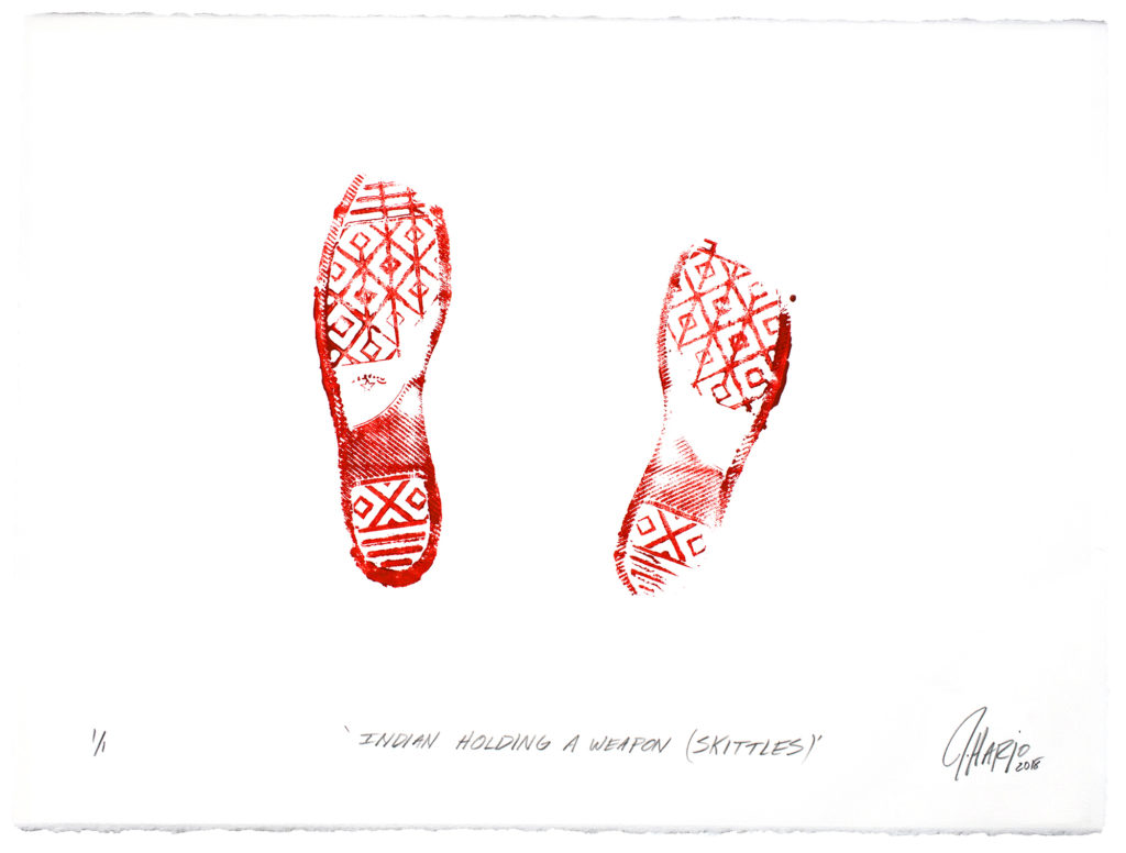 "On creamwhite paper, in brightred ink, the imprint of footwear with a complex tread, made up of voided lozenges under the sole and heel, horizontal bars at the toe and end of the heel, and an oblique block under the arch beginning at the heel and ascending to the instep halfway up. Vertical bars transverse the voided lozenges along the sole, bisecting them. Both feet are splayed slightly outward, that on the left only barely, and slightly ahead. The inner tip of the toe of the left foot has not made contact with the paper, nor have the toe and the outer edge of the heel of the right. Beneath, in blackinked oblique print hand, ""INDIAN HOLDING A WEAPON (SKITTLES)"", and in the bottom right corner, the cursive signature J Harjo 2018"", where the data is in subscript."