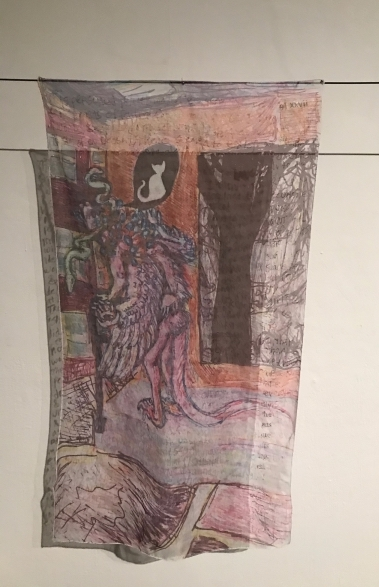 On two black cords, before a pale wall, hang sheets of sheer cloth or transparent paper. The front hanging is marked with an image: before a brick red wall, an incarnadine humanoid figure stoops toward a vermillion barred rectangular portal. The figure has a tail, feathered arms, clawed feet and hands, and serpents, feathers or fur, and blebs or pustules upon its back and head. The figure walks with a black cane or walker. In the red wall, above the figure in a round black niche, sits a white cat, facing away. In a larger rectangular cavity to the right, a dark tree is visible upon a lighter void. The figure stands upon light lavender ground; before which proceed rectangles of black and pink, framed with white lanes. On the back hanging, there is hand printed text, largely illegible.