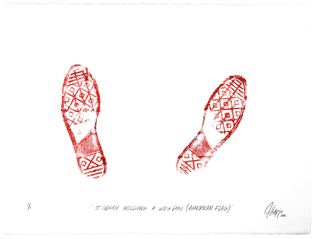 """On creamwhite paper, in brightred ink, the imprint of footwear with a complex tread, made up of voided lozenges under the sole and heel, horizontal bars at the toe and end of the heel, and an oblique block under the arch beginning at the heel and ascending to the instep halfway up. Vertical bars transverse the voided lozenges along the sole, bisecting them. Both feet are splayed slightly outward, that on the right moreso. Beneath, in blackinked oblique print hand, """"INDIAN HOLDING A WEAPON (AMERICAN FLAG)"""", and in the bottom right corner, the cursive signature J Harjo 2018"""", where the data is in subscript."""